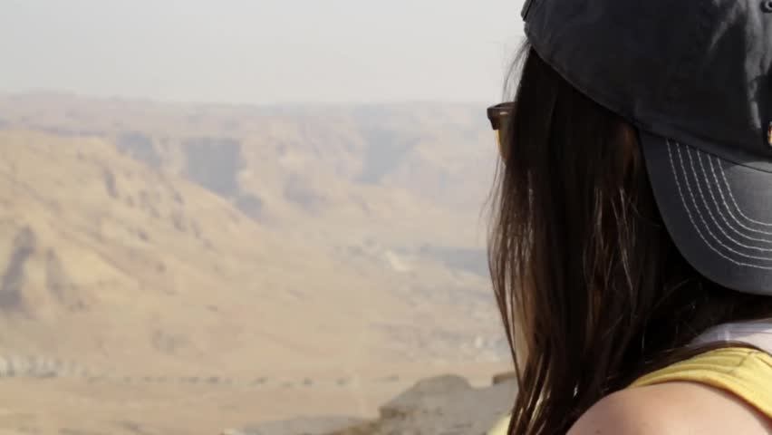 Girl looking to the desert landscape. POV and Change focus.