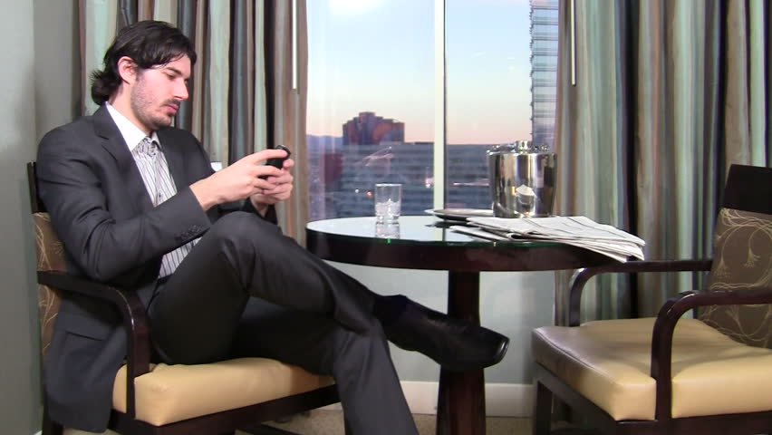 Businessman text in hotel room - HD - HD stock video clip