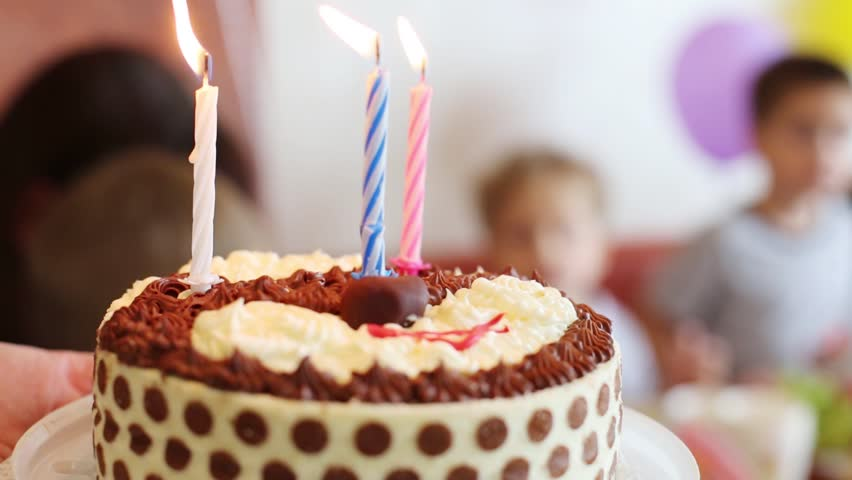 Female hands hold birthday cake with three candles - HD stock video clip