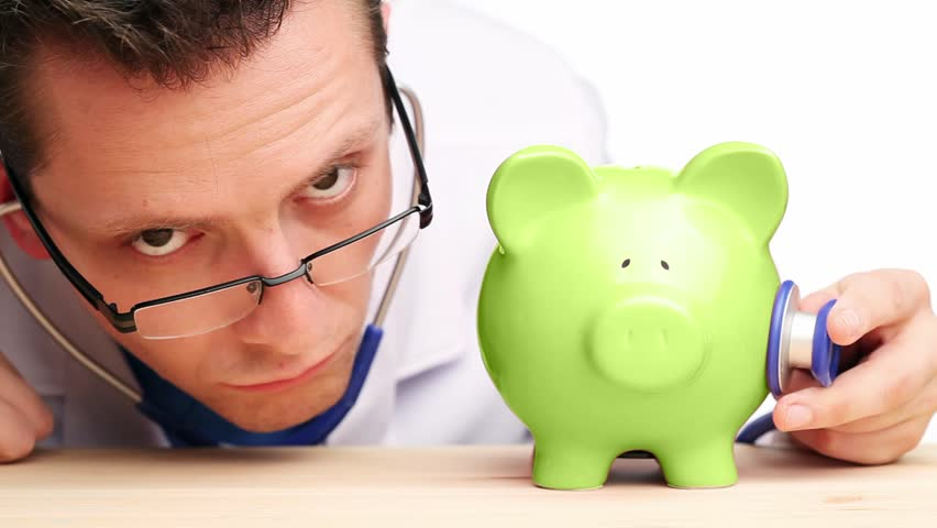 Sick Piggy Bank gets cured - HD stock footage clip