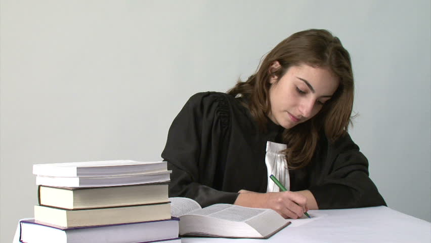 Young law school student taking notes from a book - HD stock video clip