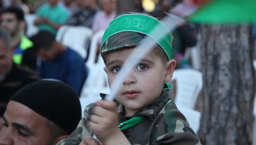 MAHARAL FOREST, ISRAEL - MAY 15, 2015: Arab Israelis boy with flag during Nakba Day, a commemoration of the displacement that preceded the Israeli Declaration of Independence in 1948