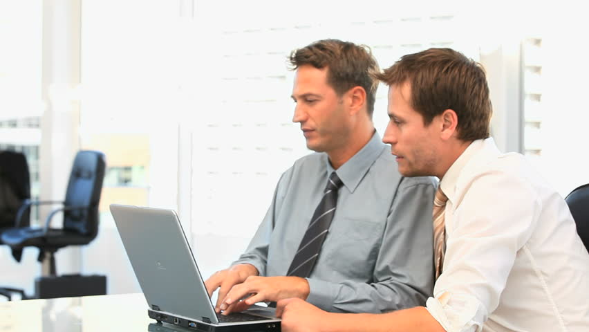 Coworkers working together on a laptop - HD stock video clip
