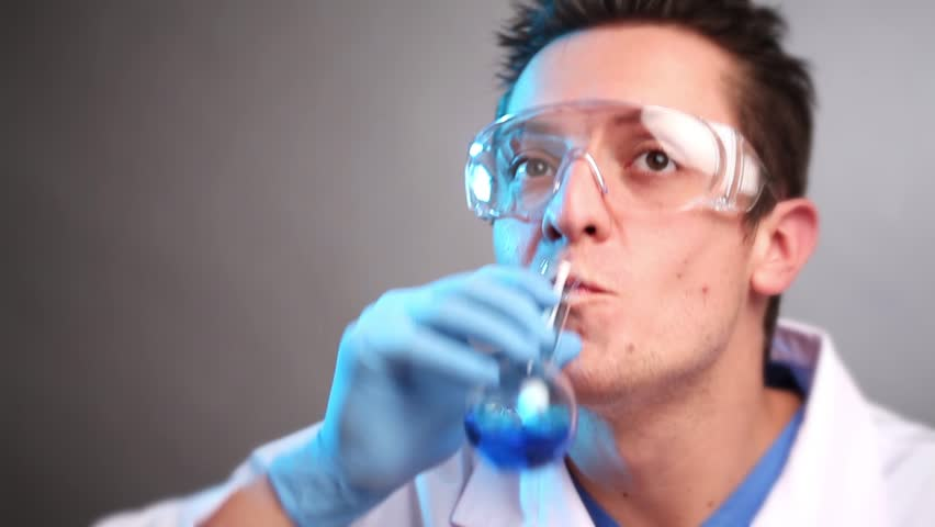 Mad scientist drinking chemicals - HD stock video clip