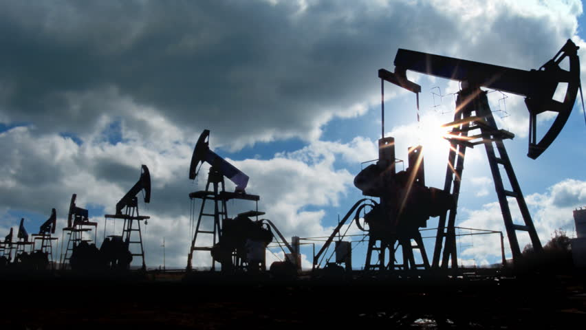 working oil pumps silhouette against timelapse clouds - HD stock video clip