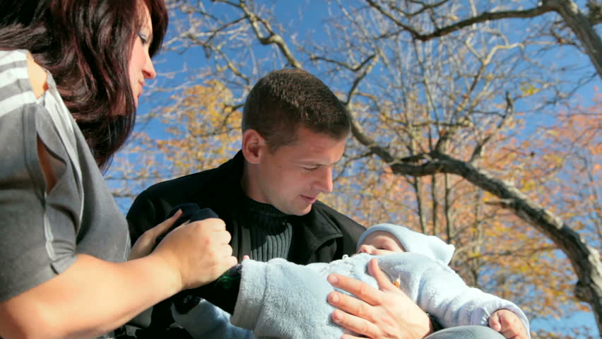 happy family, father with a baby in his arms - HD stock video clip
