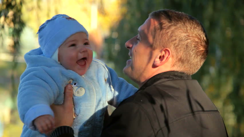 baby in the hands of her father - HD stock video clip