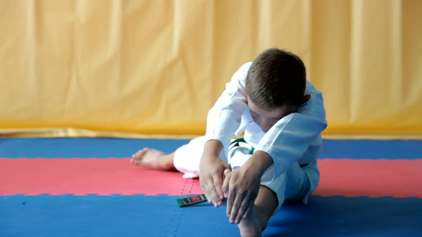 Young Boy Stretching Before Karate Stock Footage Video ...