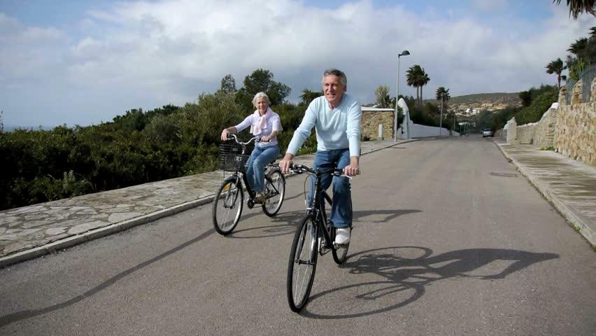 Senior couple riding bicycles #1034425
