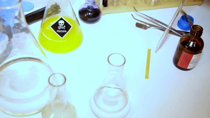 Mad professor conducts strange experiments with different chemical material. - HD stock footage clip