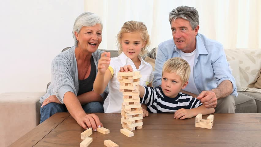 Family playing a game in the living room - HD stock video clip