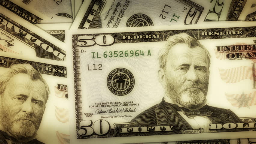 A pile of dollar notes gets smaller and opens up a hole with chroma key. - HD stock video clip