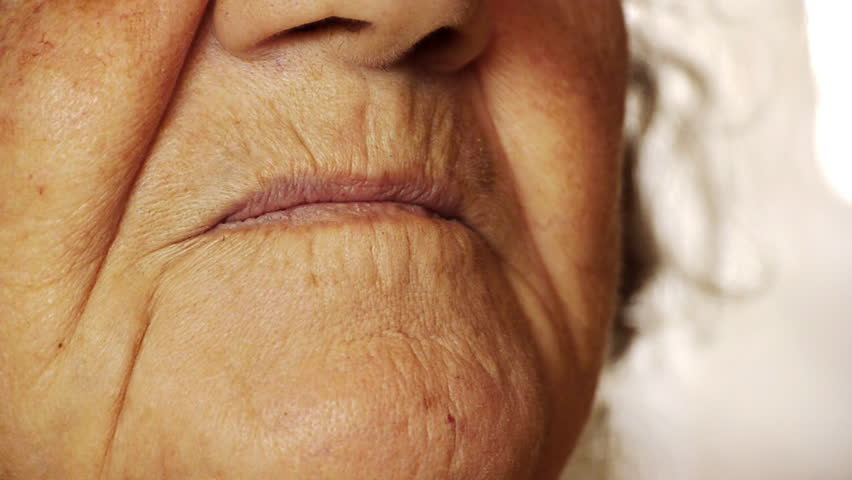 Senior old woman smile mouth wrinkle skin close up  - HD stock footage clip