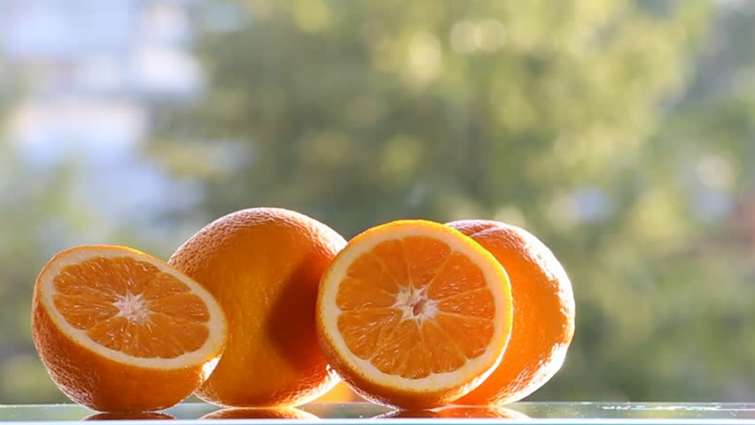 Oranges are on the table,on green background.