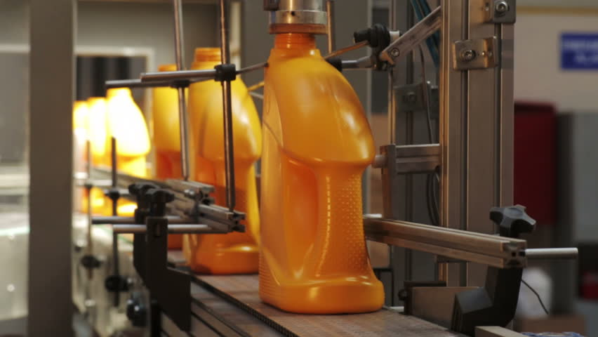 Production line. packing private label products, no name products, plastic bottles