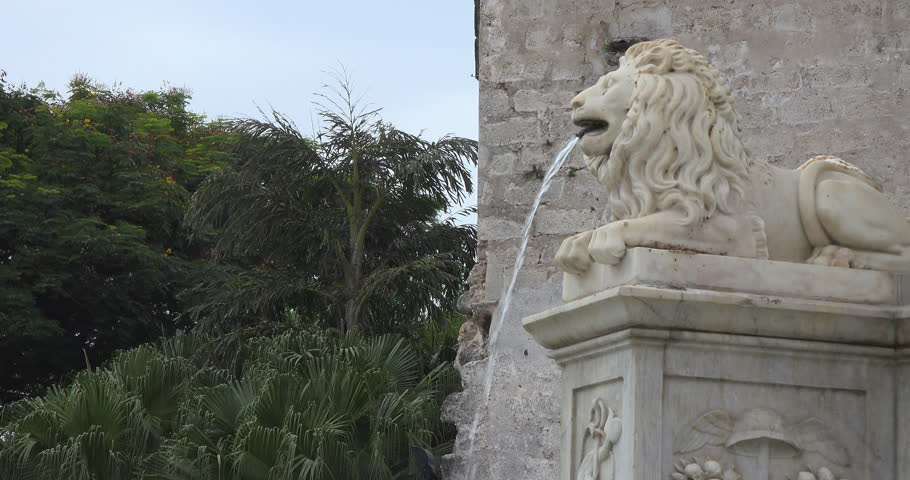 HAVANA,CUBA-JANUARY 20,2015: Lion fountain in the Old Plaza in Old Havana which is a UNESCO World Heritage Site and a tourist landmark in the Caribbean Island
