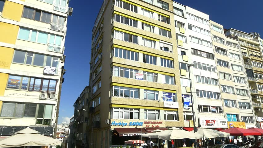 ISTANBUL - MAY 4, 2015: Harbiye Houses in Istanbul. A street of massive blocks of flats for residents and various travel agencies on Cumhuriyet Street