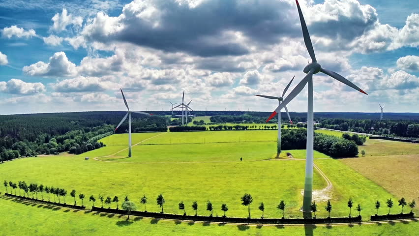 Aerial view of summer countryside with wind turbines and agricultural fields. Full HD, 1080p