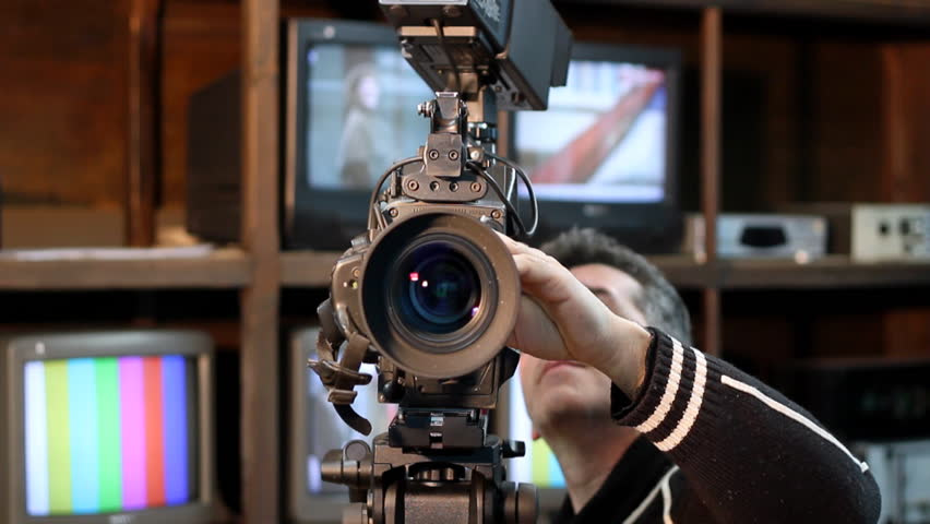 Camera operator using a camera. Broadcast Television.  Media Occupation. Television Studio. Panning shot.  HD1080p. - HD stock video clip
