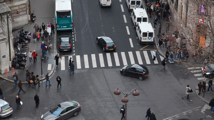 Busy traffic at intersection and crosswalk in center of Paris by day, top view   Shutterstock HD Video #1064557