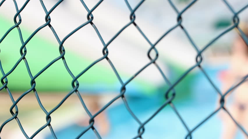 blurry water park behind a fence