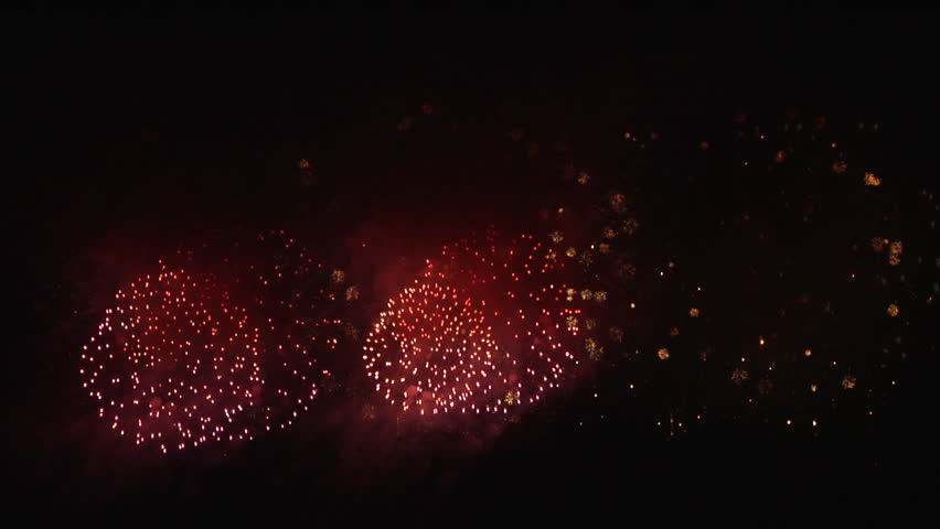 Extract from a huge fireworks display from a festival: Widescreen fireworks composition - seamless loop
