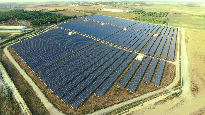 Aerial:  Photovoltaic solar units. Renewable energy system.