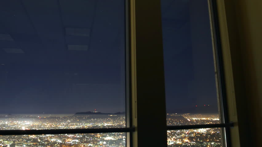 3 axis motion controlled time lapse with dolly up, tilt down, pan left & zoom out motion of night cityscape shot from high story downtown office in Los Angeles, California