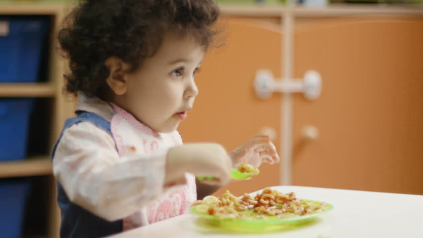 School, food, nutrition, children, baby girls eating pasta and smiling in kindergarten - HD stock footage clip
