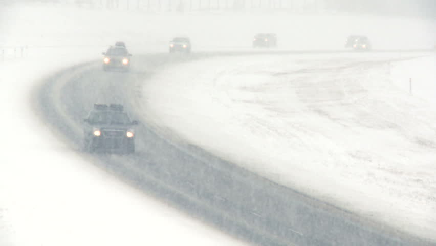 Highway traffic during blizzard