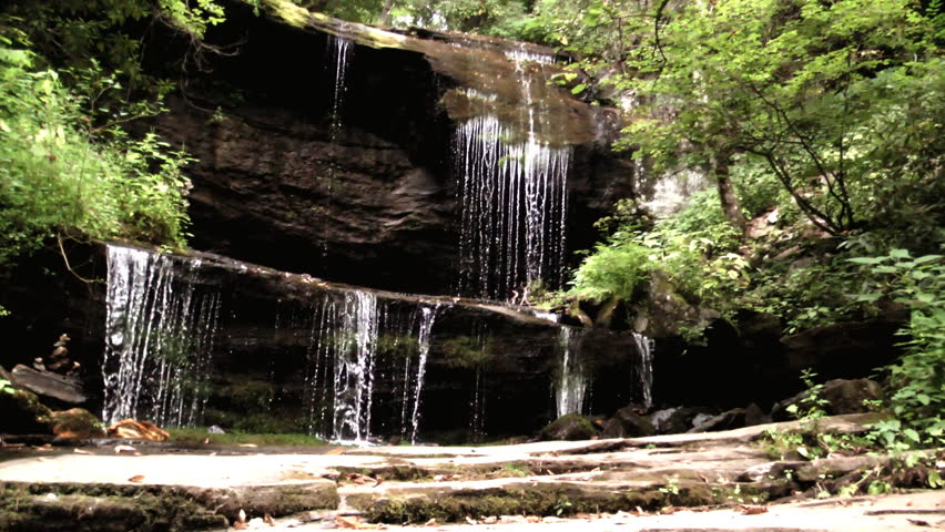 Water cascades over cliffs and rocks in the Appalachian mountain forming spectacular waterfalls even though water is a little scarce due to drought conditions in the area