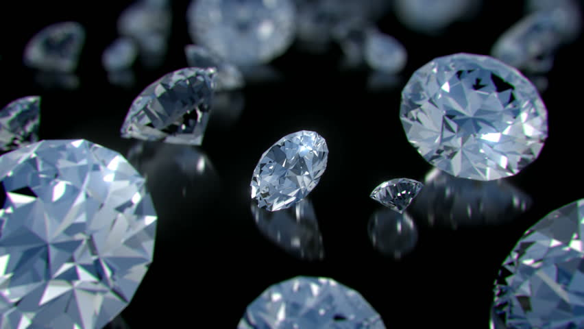 A parade of perfect diamonds rotating slowly above a glossy black surface with sparkling highlights and shallow depth of field. - HD stock video clip