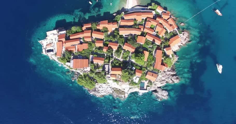 aerial view of the Sveti Stefan, small islet and resort in Montenegro, Balkans, Adriatic sea. - 4K stock video clip
