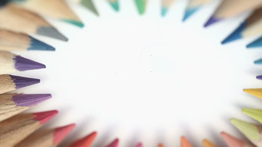 Color pencils turning on themselves on a white background - HD stock video clip
