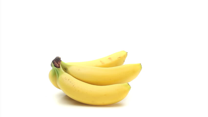 Bananas turning on themselves on a white background - HD stock video clip