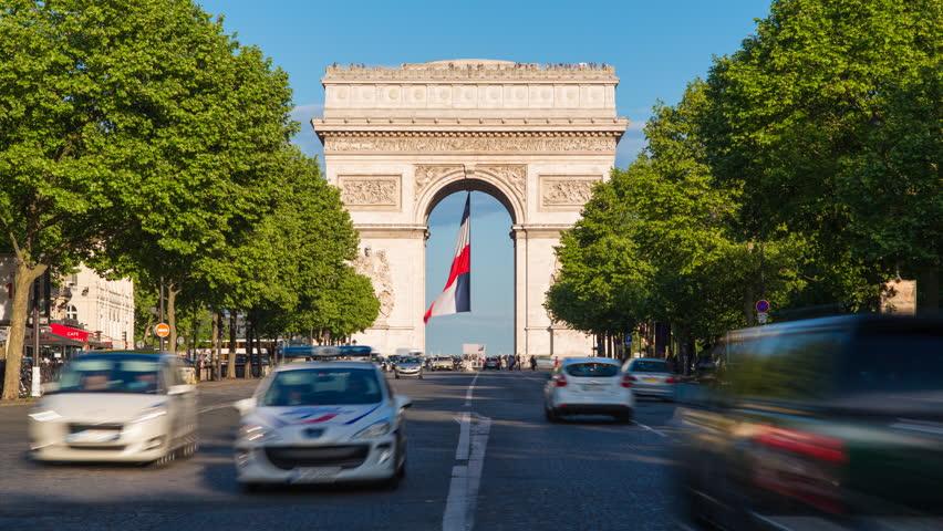 France paris etoile french flag under arc de triomphe built by napoleon timelapse stock - 10 avenue de la grande armee ...