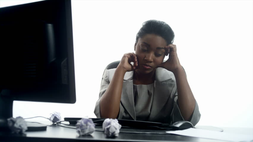 An African woman crumples notes in his office  - HD stock video clip