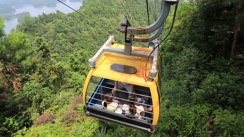Zhejiang,China-August 18,2015:Cable Car Ride in China mountain and lake area