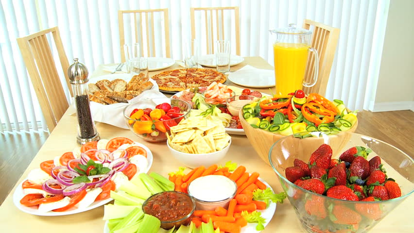 Modern Family Dining Table Full Of Fresh Tasty Food For A  : 1 from shutterstock.com size 852 x 480 jpeg 84kB