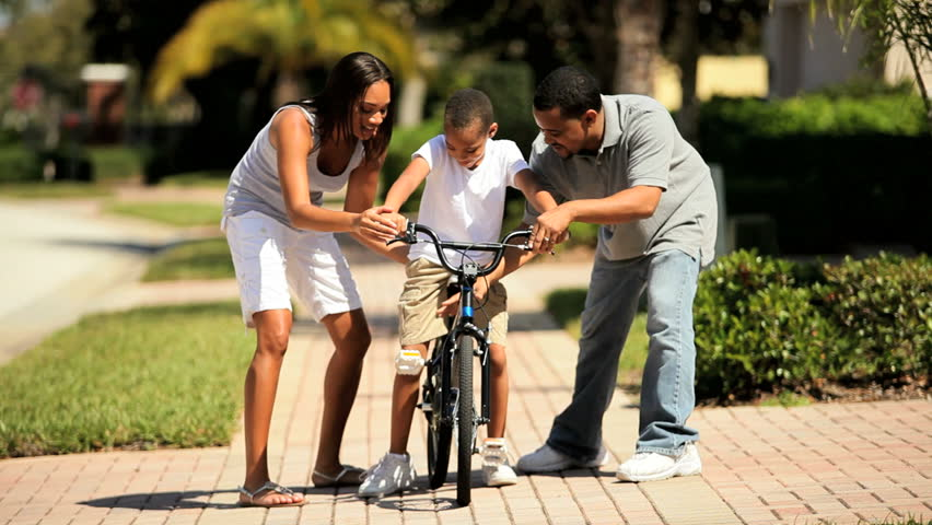African-american Boy Riding His Bicycle in First Time