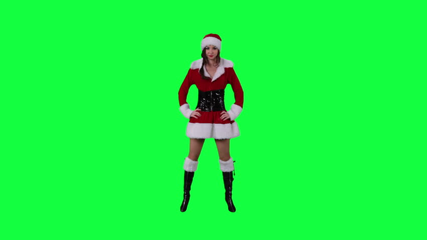 Sexy Santa's helper dancing chroma key (green screen). Sexy Santa girl dancing passionately isolated on green