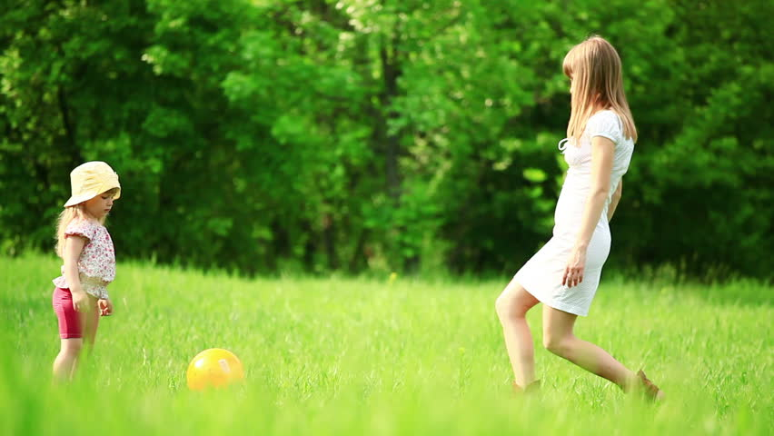 Mother and daughter play ball  - HD stock footage clip