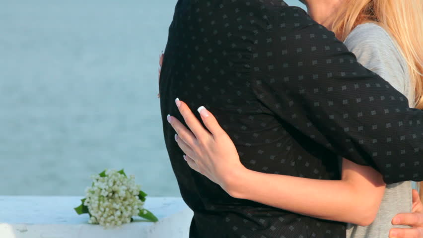 young couple  embracing at the lake - HD stock footage clip