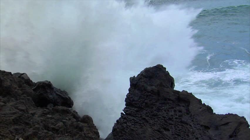 big wave crushing lava coast slow motion