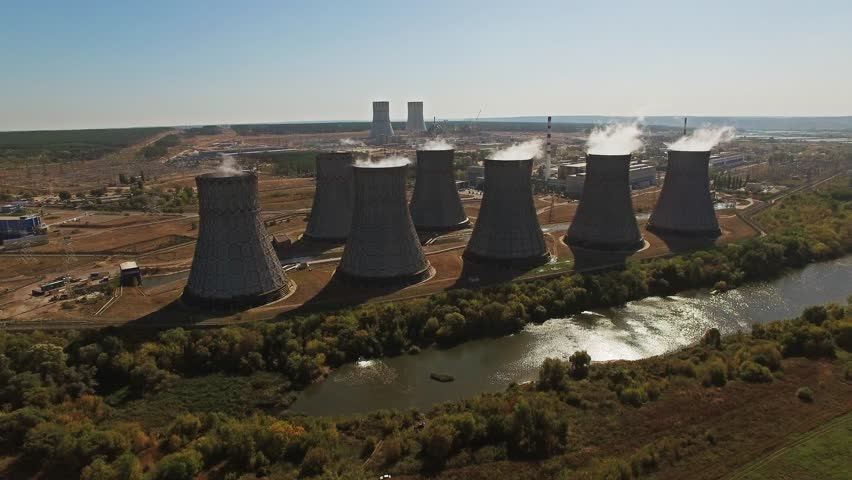 Cooling towers of nuclear power plant Aerial view.Flying down. - 4K stock video clip