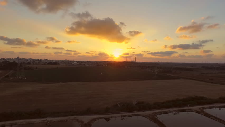 Spectacular sunset above wide fields for the screen saver on your website.