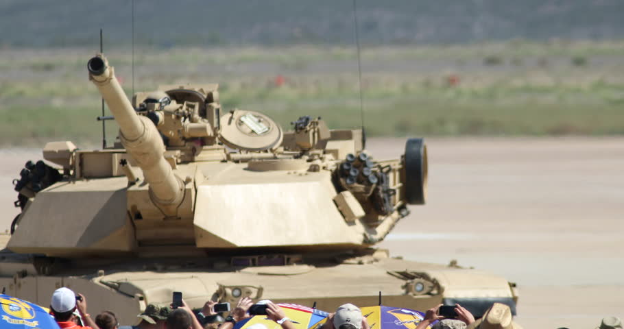 MIRAMAR, CA - OCT 3: Marines in an Abrams tank wave to the crowd during the Marine Air-Ground Task Force (MAGTF) demonstration at the airshow in Miramar, CA on Oct 3, 2015.