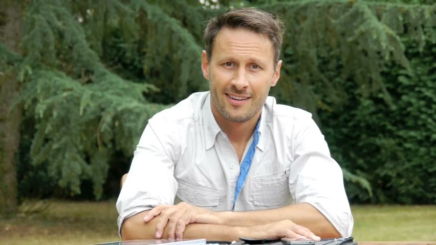 Man sitting in garden talking to camera