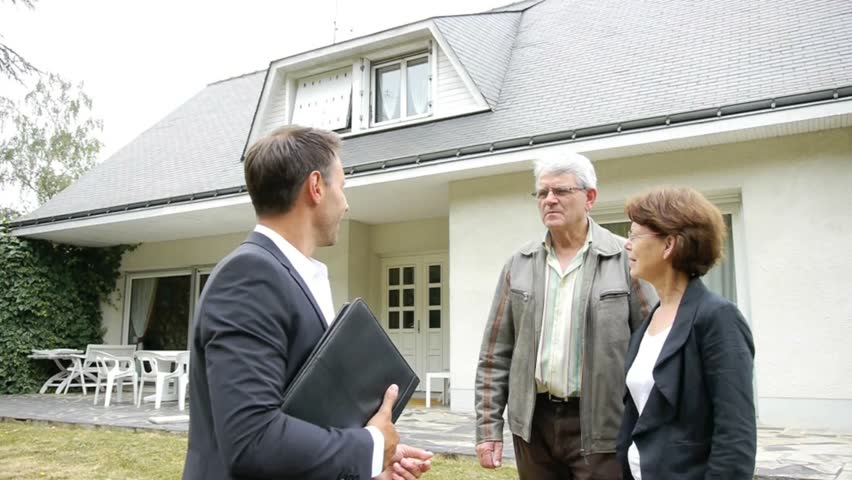 Real estate agent with senior couple buying new house for Modern house estate agents