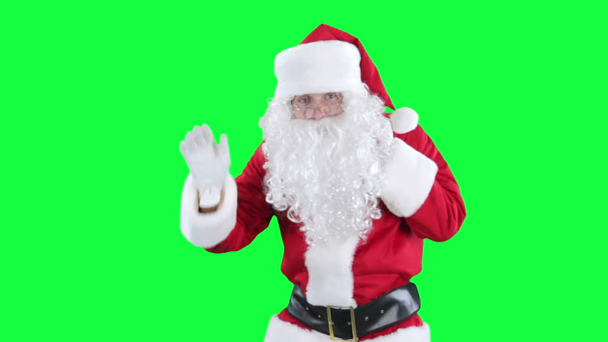 Santa Claus with gift bag chroma key (green screen). Santa is carries a red sack of presents behind him isolated on green - HD stock video clip